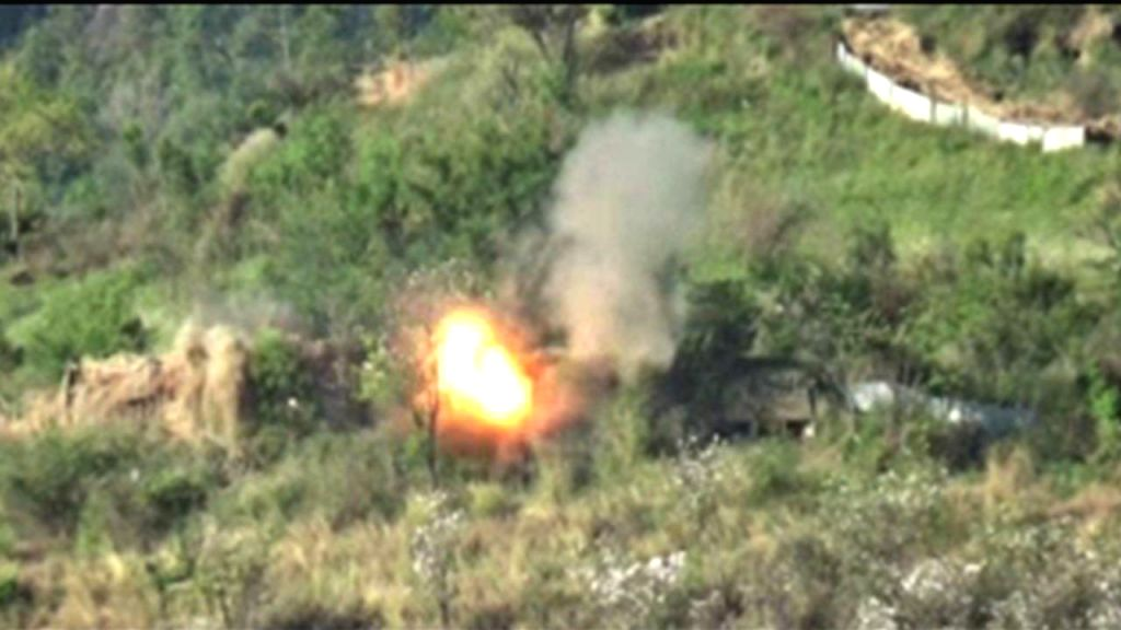 A video grab from the video clip released by Indian Army that shows  a forested area being bombed and smoke and fire billowing up after the explosion.  The Indian Army on Tuesday claimed ...