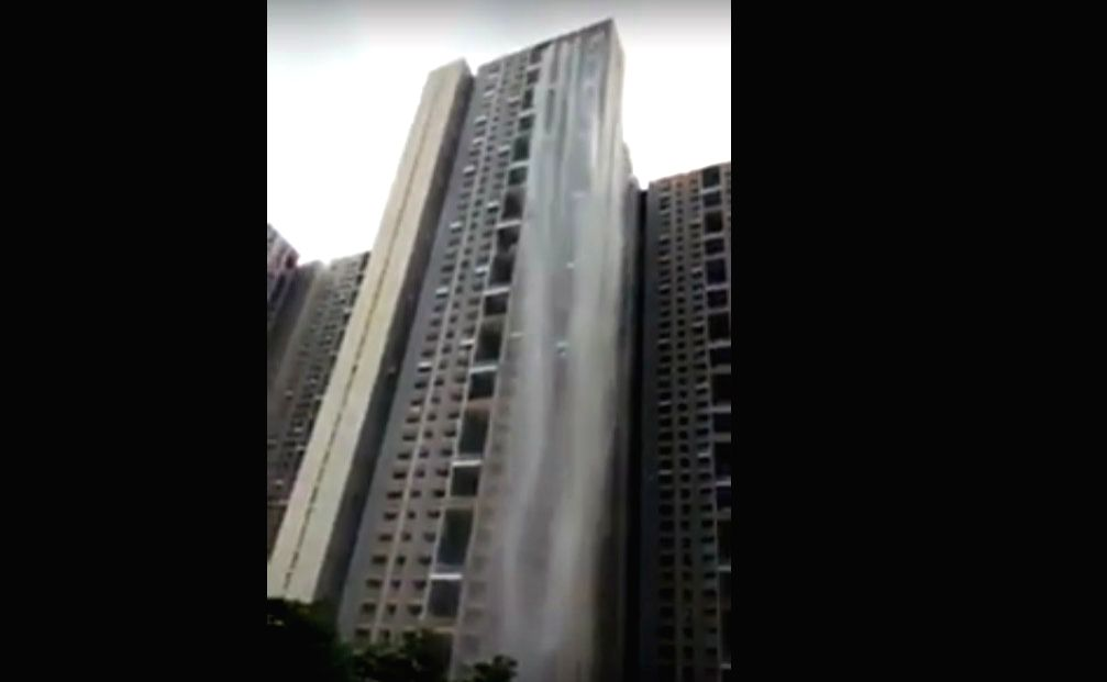 A video in which water from the top of a New Cuffe Parade skyscraper in Mumbai is gushing down from a height making it look like a tall waterfall has gone viral on the Internet. The video has been shared on Twitter by K Sudarshan on Tuesday and he ca