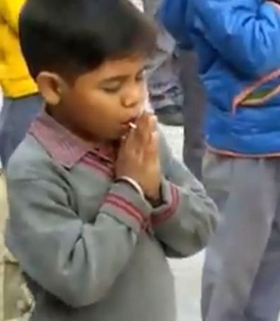 """A video of a kid sneakily enjoying a candy ring during his school prayer is doing the rounds on the social media. IAS officer Awanish Sharan took to Twitter and shared a video of the school kid with the caption, """"One can easily relate to."""""""
