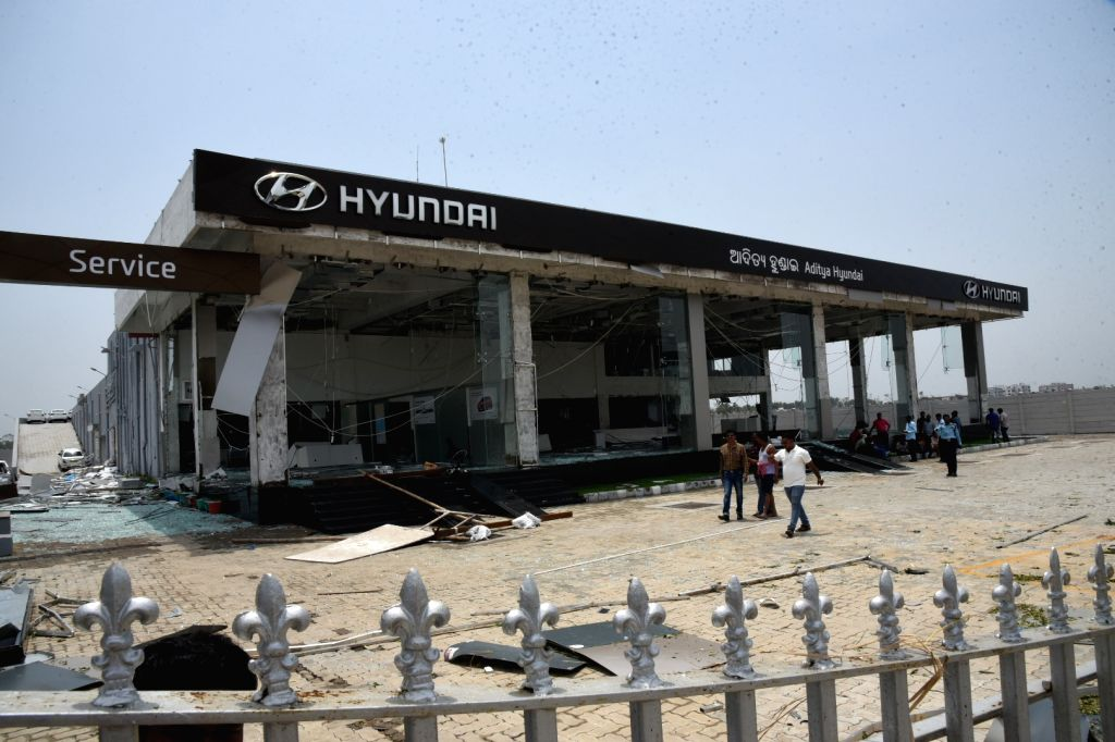 A view of a damaged automobile showroom after extremely severe cyclonic storm Fani hit the coastal state of Odisha on Friday wreaking havoc in several parts of the state; in Bhubaneswar ...