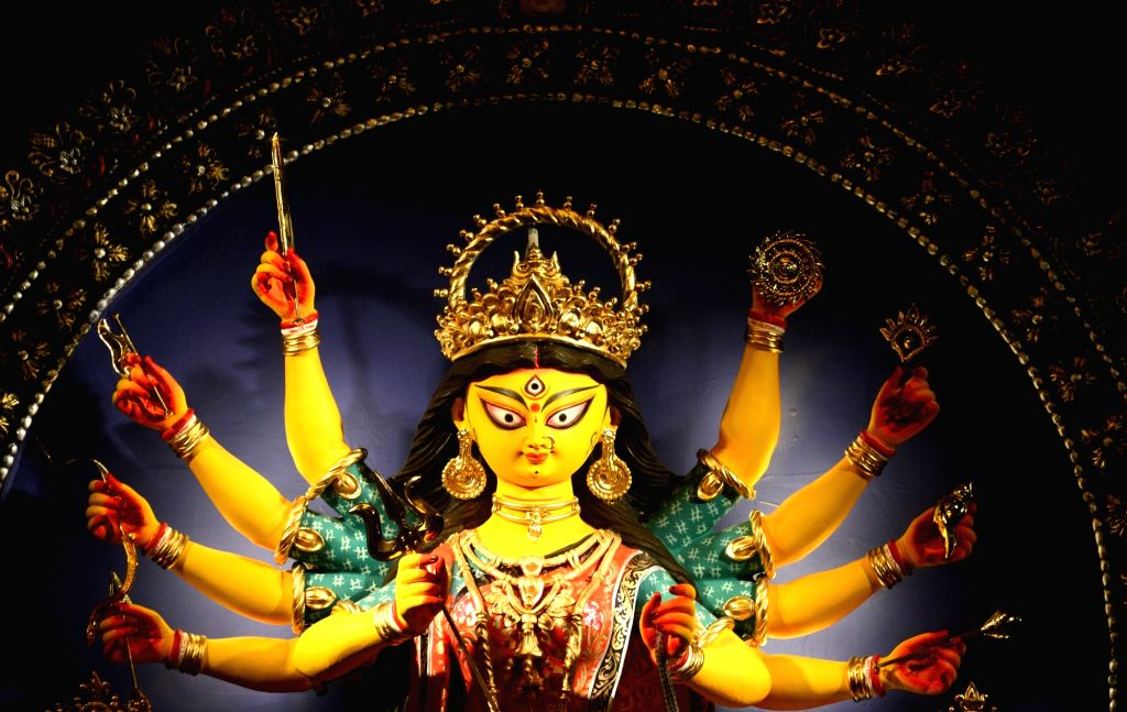 A view of an idol of Goddess Durga at a Community Puja pandal at Dum Dum Park Bharat Chakra on Shashti during Durga Puja celebrations in Kolkata on Oct 22, 2020.
