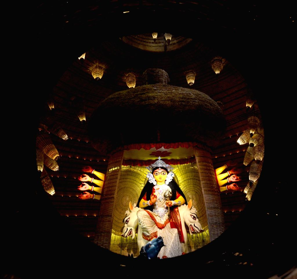 A view of an idol of Goddess Durga at a Community Puja pandal at Dum Dum Tarun Dal on Shashti during Durga Puja celebrations in Kolkata on Oct 22, 2020.