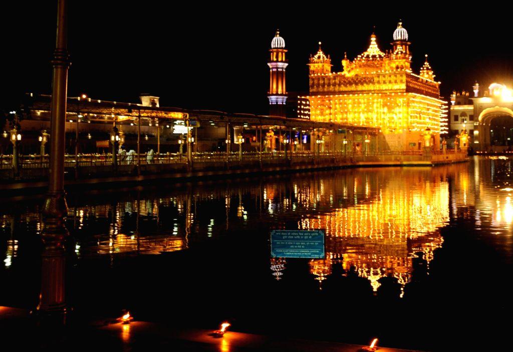 A view of an illuminated Golden Temple on the occasion of Sikhs third Guru, Guru Amar Das Ji's birth anniversary in Amritsar on May 6, 2020.