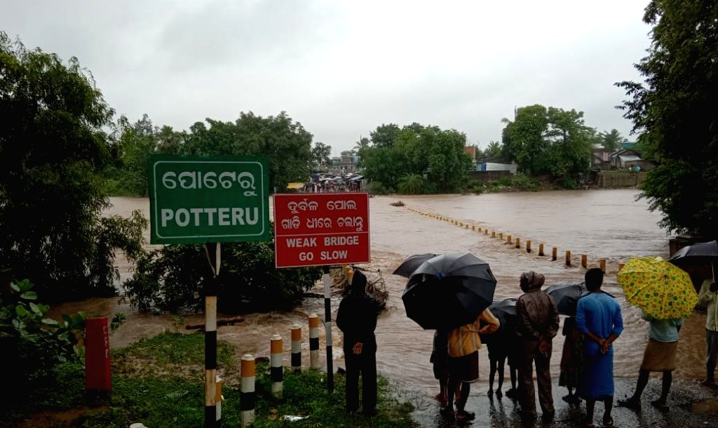 A view of an inundated bridge after incessant rains triggered a flood-like situation in Odisha's Malkangiri, on July 29, 2019.