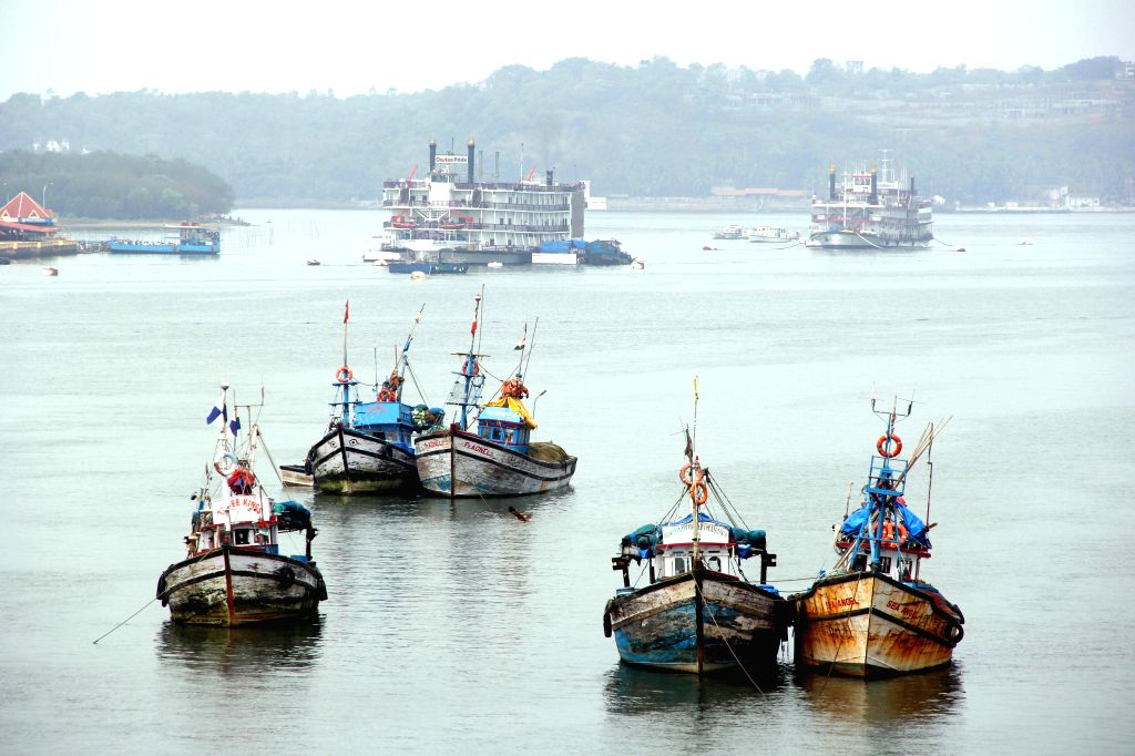 A view of anchored fishing trawlers on Mandovi river in Panaji on April 28, 2014.