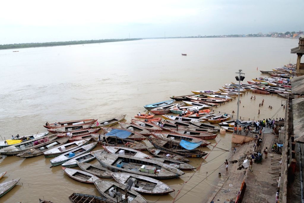 A view of boats anchored at the banks of swollen Ganga river, in Varanasi on Aug 1, 2018.