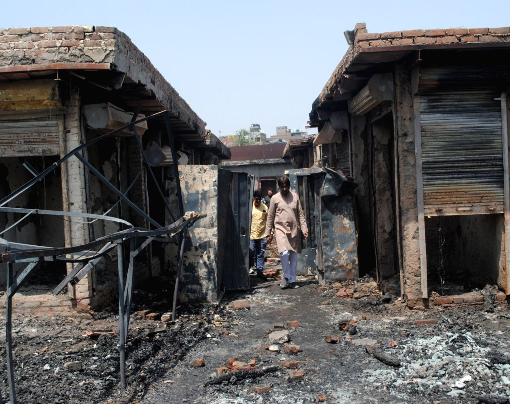 """A view of Burn shops and Eight people rescued from the fire in a furniture market in Shastri Park. """"Fire was reported at 12:45 am & involved around 250 furniture & hardware ..."""