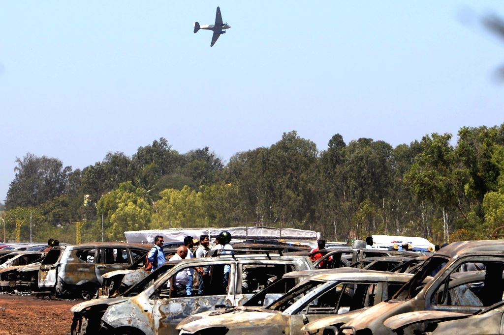 A view of burnt-out cars, where a fire broke out at the parking lot in front of Yelahanka Air Force Station gutting 300 cars, in Bengaluru, on Feb 24, 2019.