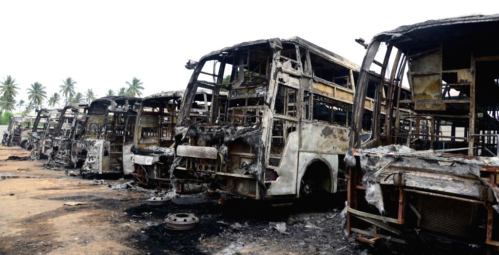 A view of buses that were torched by protesters in Bengaluru on Sept 13, 2016.
