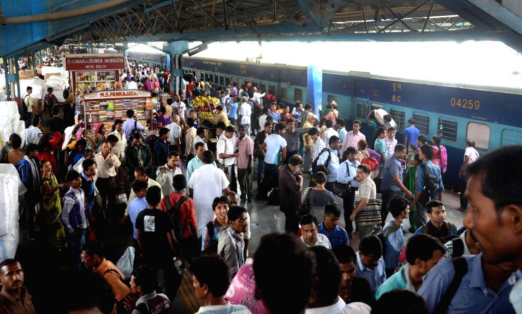 A view of  bustling New Delhi Railway Station as Union Railway Minister D.V. Sadananda Gowda presents rail budget 2014-15 in the Parliament on July 8, 2014. - D.