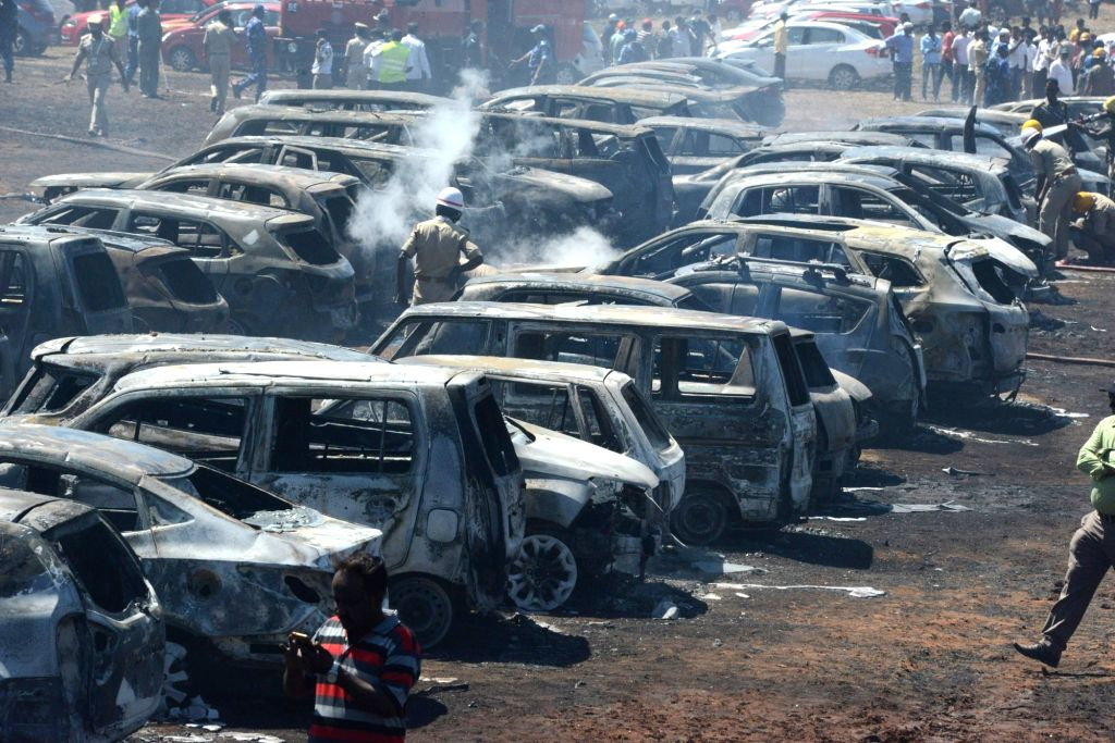 A view of cars that were gutted in a fire that broke out in the parking lot in front of Yelahanka Air Force Station gutting 300 cars, in Bengaluru on Feb 23, 2019. The fire, which began at ...