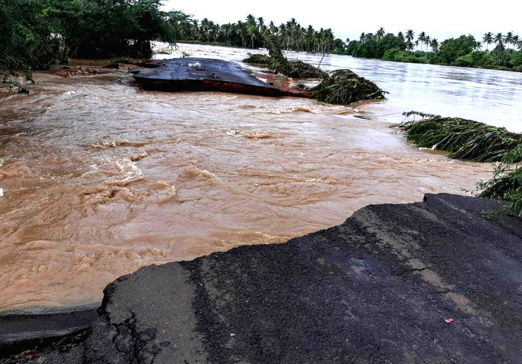 A view of damaged Hubballi-Sollapur road following Malaprabha river flood in Bagalkot on Aug 11, 2019.