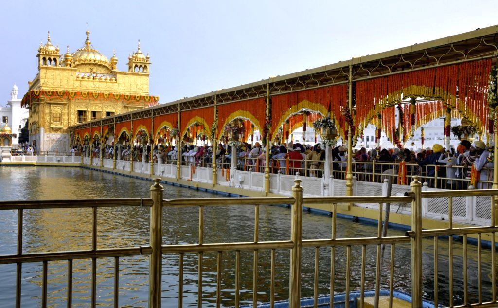 A view of decorated Golden temple on the eve of 413th Parkash Purab of Sri Guru Granth Sahib Ji in Amritsar on Aug 21, 2017.