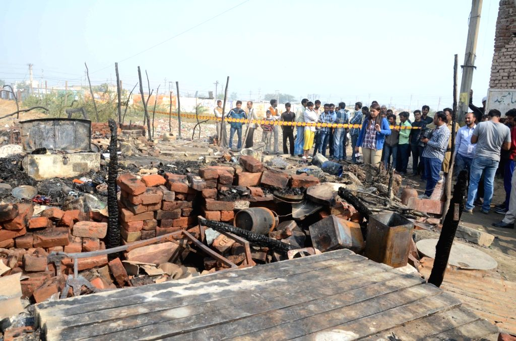 A view of destroyed houses in North Delhi's Bhalswa where a major fire broke out killing five people on Nov 23, 2015.