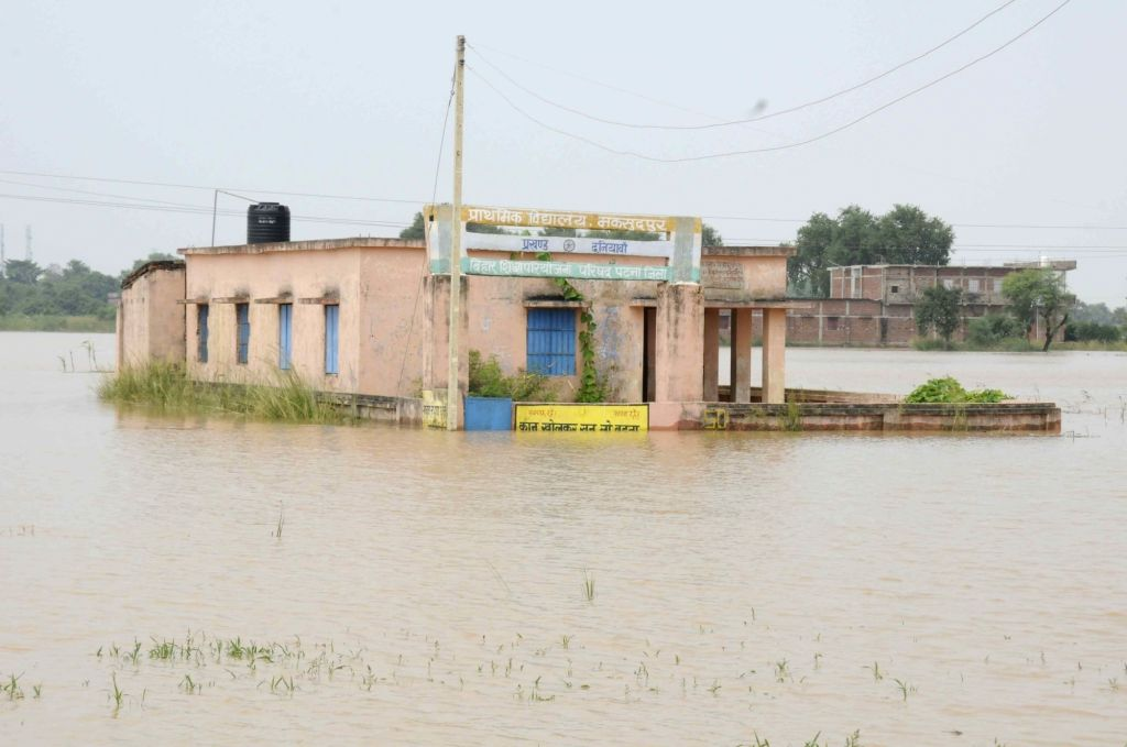 A view of flooded Maksoodpur village near Patna on Aug 14, 2016.