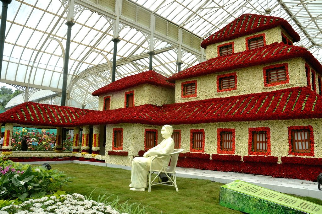 "A view of floral replica of Kannada poet Rashtrakavi Kuvempu's house ""Kavishala"" using Dutch White and Red roses at Glass House Lalbhag in Bengaluru on Aug 4, 2017."
