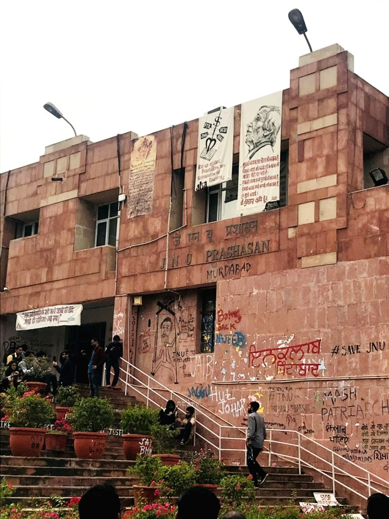 A view of graffiti painted by students on the walls and floor at the administrative block of Jawaharlal Nehru University in New Delhi on Nov 14, 2019. The protesting JNU students expressed ...