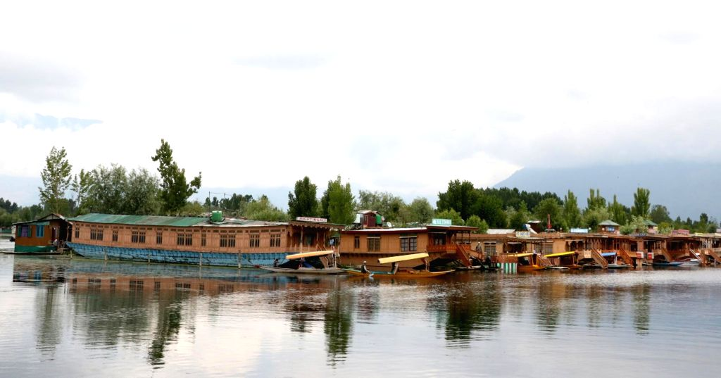 A view of house boats and shikaras anchored on the banks of Dal lake, in Srinagar on May 20, 2018.