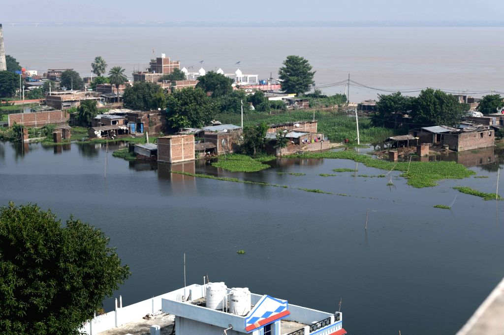 A view of houses submerged in water as Ganga River overflows, in Patna on Sep 22, 2019.