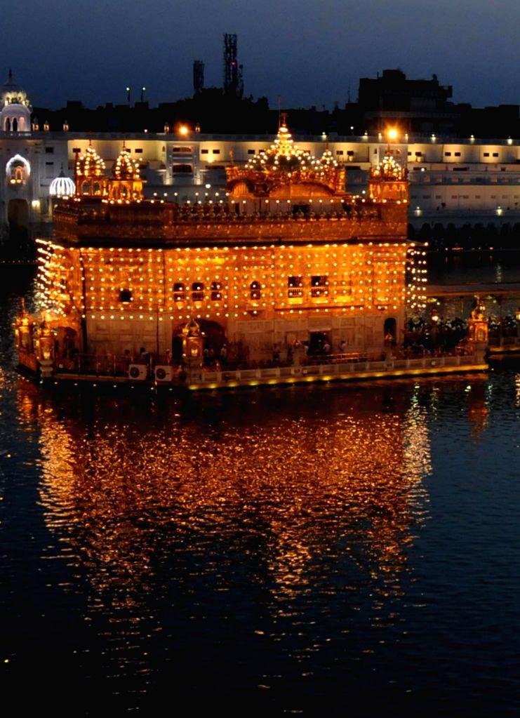 A view of illuminated Golden Temple  ahead of the birth anniversary of Guru Tegh Bahadur in Amritsar on April 16, 2017.
