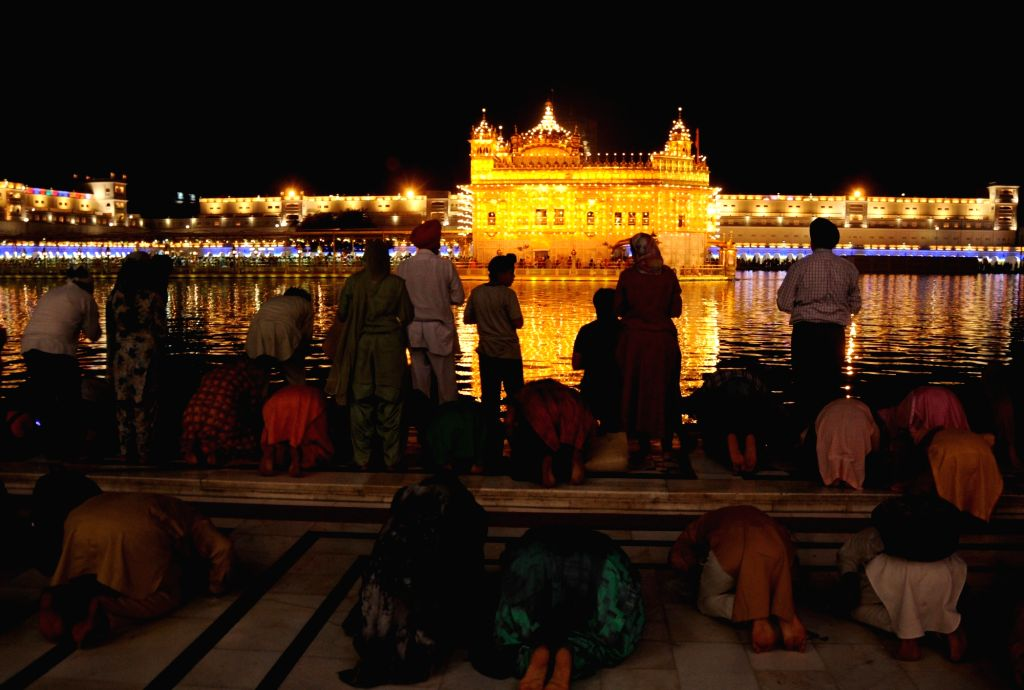 A view of illuminated Golden Temple on the occasion of the birth anniversary of fifth Sikh master Sri Guru Arjan Dev Ji, in Amritsar on April 7, 2018.