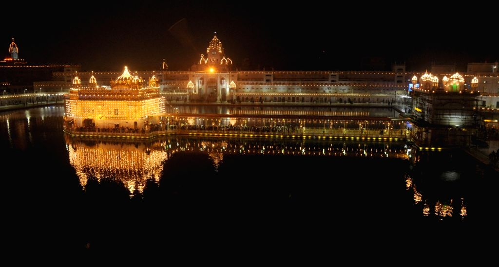 A view of illuminated Golden Temple on the eve of eve of the birth anniversary of the 10th Sikh Guru Gobind Singh in Amritsar, on Jan 15, 2016. - Guru Gobind Singh