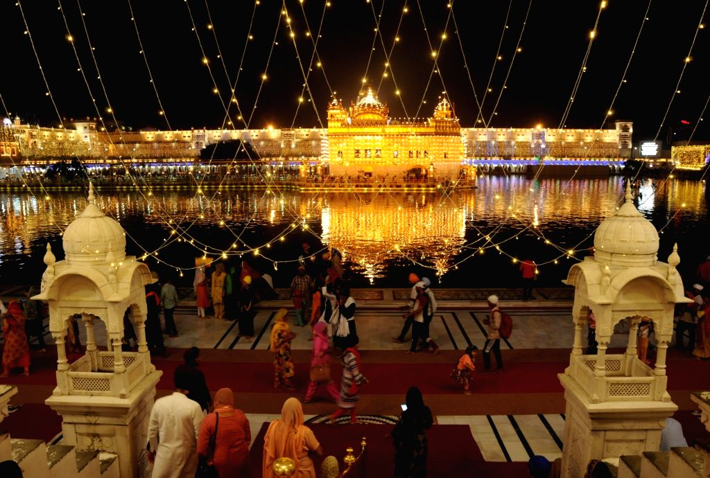 "A view of illuminated Golden Temple on the eve of ""Bandi Chhor Divas"" that coincides with Diwali in Amritsar on Oct 26, 2019."