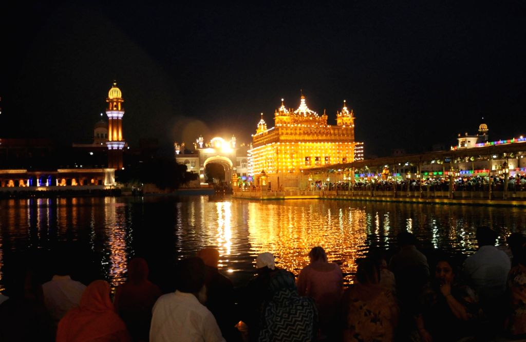 A view of illuminated the Golden Temple ahead of the birth anniversary of Guru Tegh Bahadur in Amritsar on April 5, 2018.
