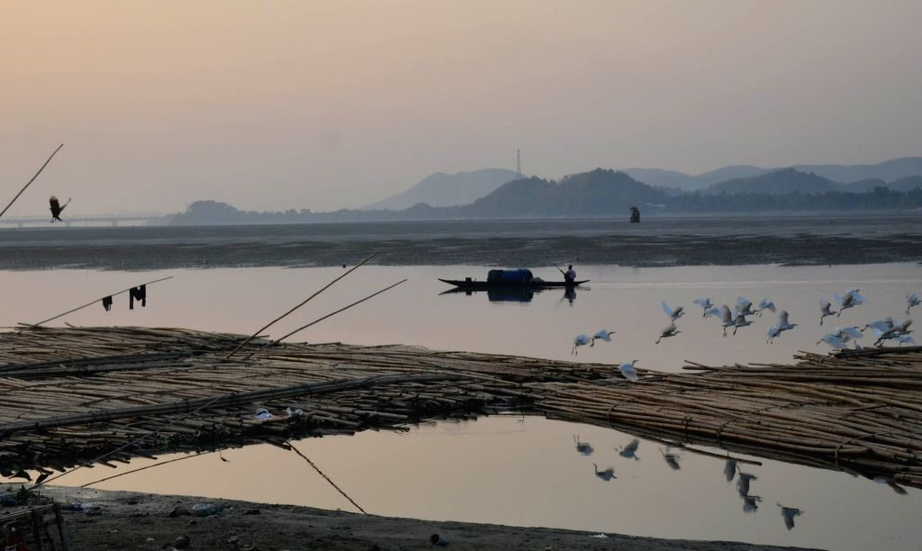 A view of landscape as seen from the banks of the Brahmaputra river at dusk in Guwahati on Dec 14, 2018.