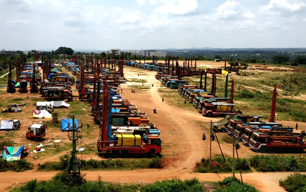 A view of lorries parked at an open ground on the outskirts of Bengaluru by Karnataka Rig Owners Association to protest against rising fuel prices, on Sept 15, 2018.