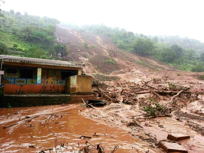 A view of Malin village after a hillock crashed on the village near Pune early morning on July 30, 2014. At least 25 people were killed and over 160 remain trapped. With barely six structures of the .