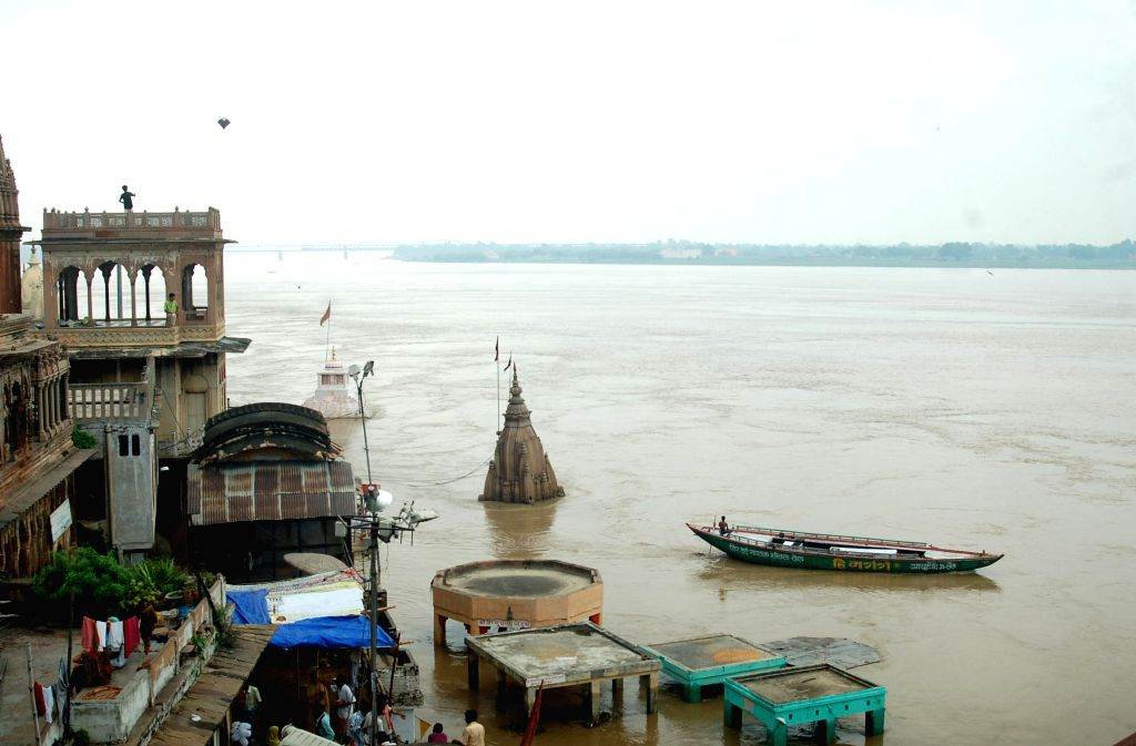A view of Manikarnika Ghat as water level in the Ganga river rises in Varanasi on Aug 11, 2014.