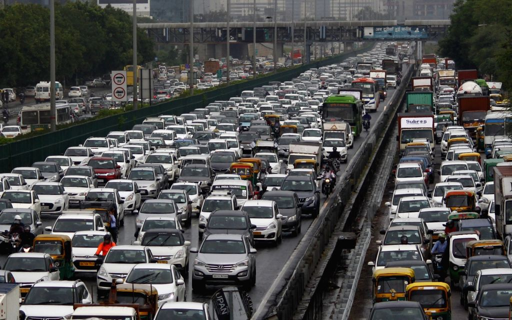 A view of massive traffic jam after rains, at Delhi-Gurugram Expressway near IFFCO Chowk in Gurugram, on July 18, 2019.