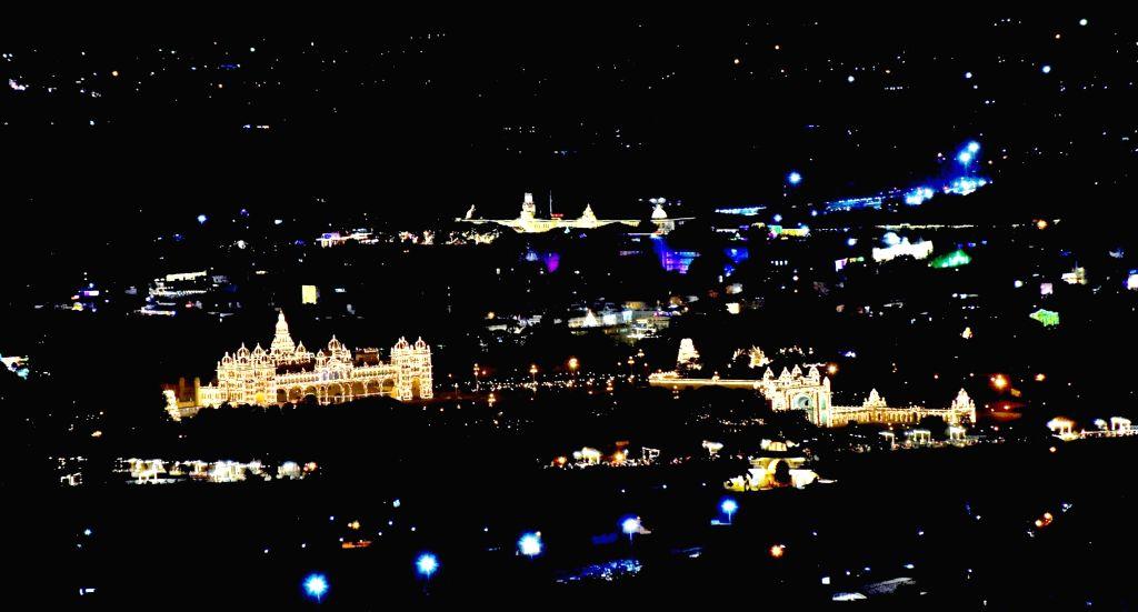 A view of Mysuru city and palace beautifully illuminated with lights during Dasara celebrations, as seen from Chamundi Hills in Mysuru on Oct 22, 2020.