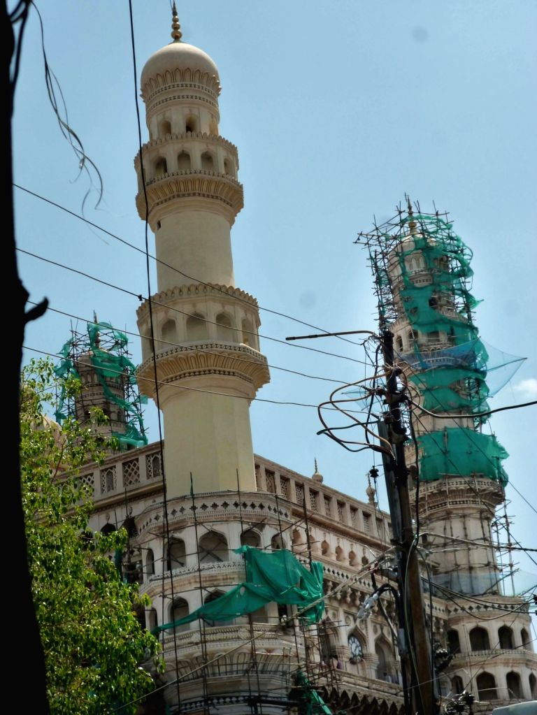"""A view of one of the minars of the """"Charminar"""" after chemical washing carried out by Archaeological Survey of India in Hyderabad, on May 29, 2016."""