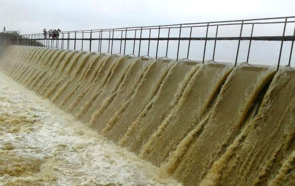 A view of overflowing Himayat Sagar Dam built on Esi a tributary of Musi River near Hyderabad in Telangana on Aug 31, 2014.