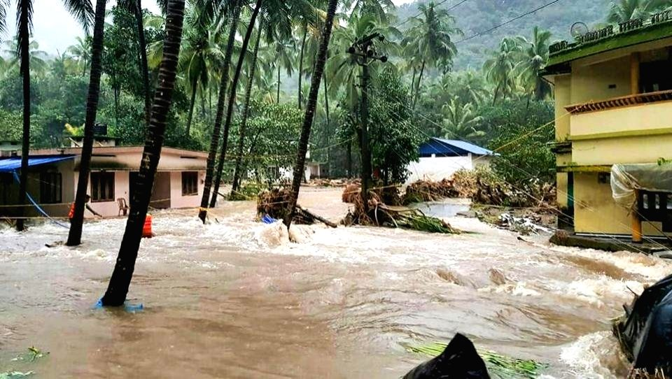 A view of partially submerged houses in rain water, at flood affected areas, in Thiruvananthapuram, Kerela, on Aug 10, 2018.