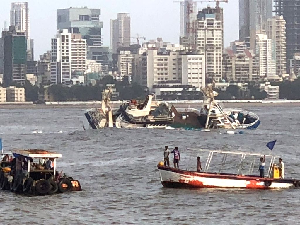 A view of popular floating restaurant 'Ark Deck Bar' that capsized and sank partially off the coast near Bandra, Mumbai under the possible impact of huge tidal waves triggered by the Mekunu ...