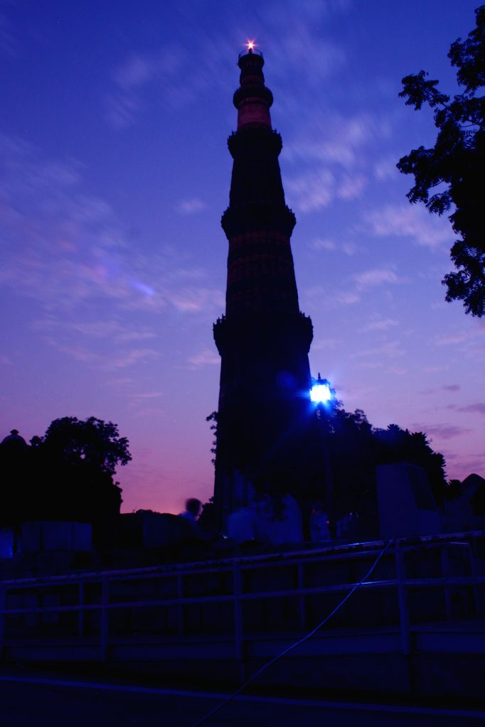 A view of Qutub Minar illuminated with symbolic blue colour of the United Nations as part of the worldwide celebrations of the 70th anniversary of the United Nations in New Delhi, on Oct ...