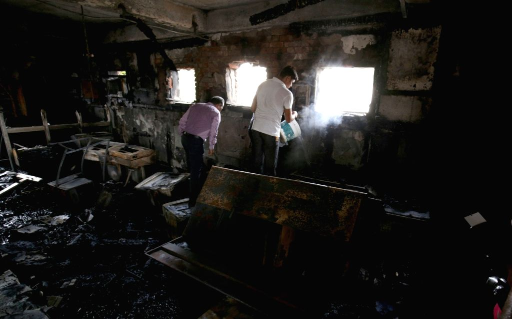 A view of reservation counter of Amritsar railway station after a fire broke out on June 30, 2016.