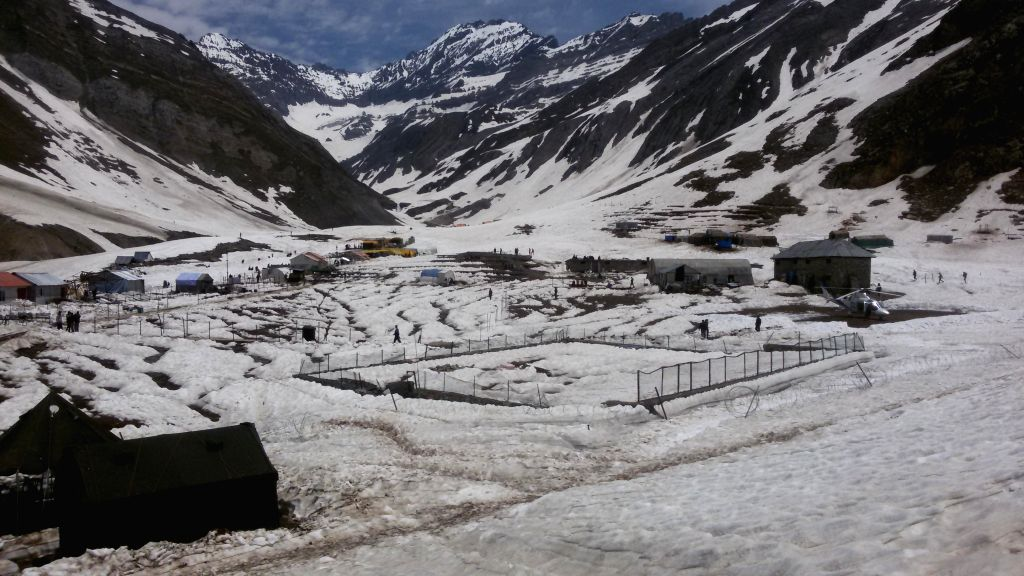 A view of snow-clad Sheshnag base camp in Jammu and Kashmir on June 25, 2014. The Amarnath Yatra in the state this year will begin only through the Baltal base camp route June 28 while a decision on .