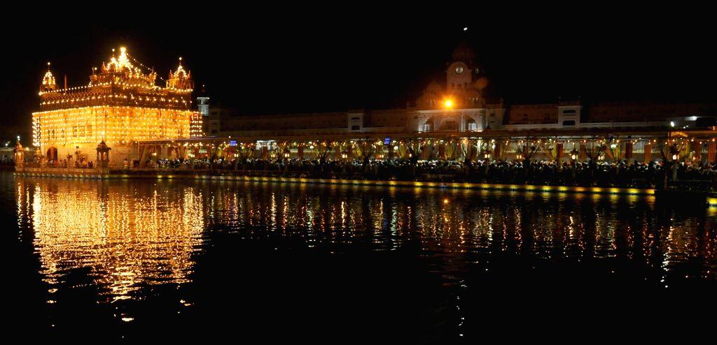A view of spectacularly illuminated Golden Temple on the Gurpurab of Guru Ram Dass in Amritsar, on Oct 29, 2015.