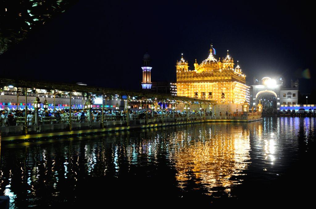 A view of spectacularly illuminated Golden Temple on  'Gurta Gadhi Diwas' of sixth Sikh master, Guru Hargobind in Amritsar, on June 7, 2018.