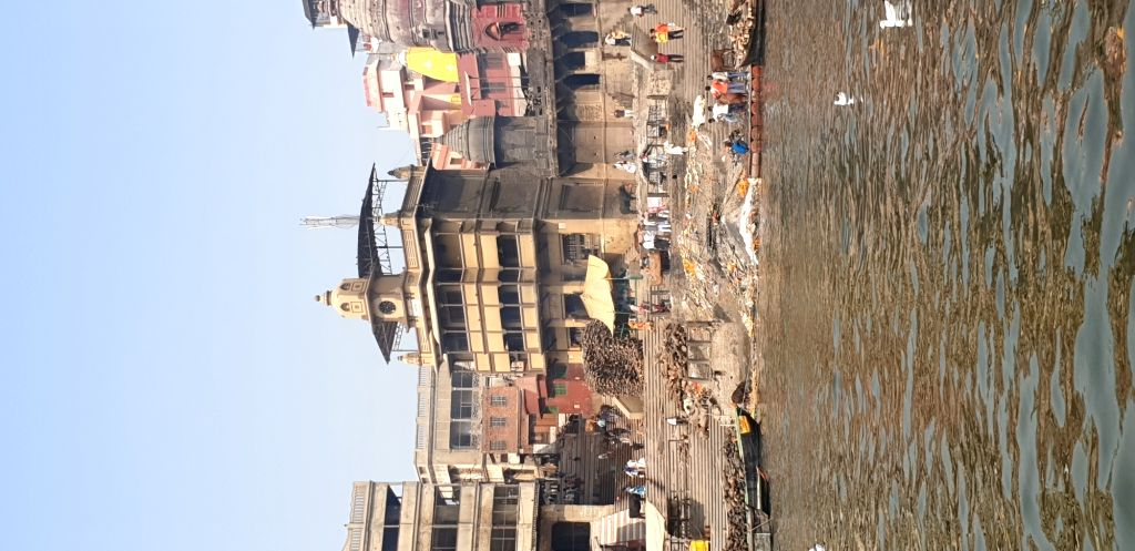 A view of stacks of wood piled on one of the burning ghats of Varanasi's as seen from a boat.