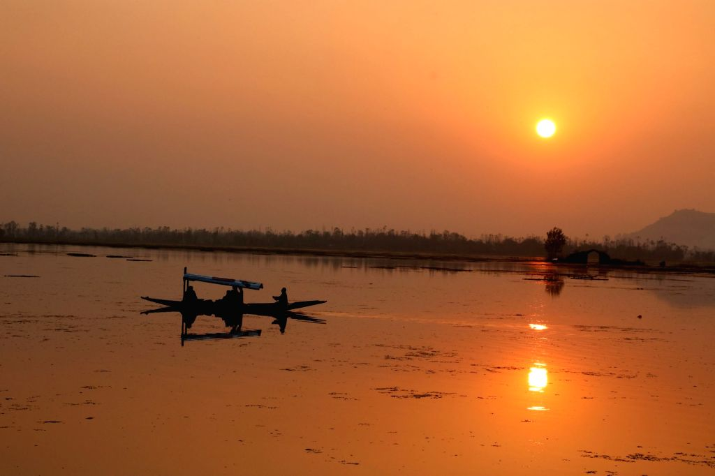 A view of sunset as seen from the banks of Dal Lake in Srinagar on Nov 14, 2015.