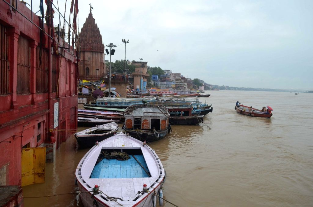 A view of swollen Ganga river in Varanasi on July 29, 2018.