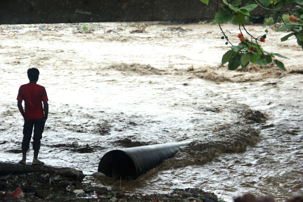 A view of swollen Rispana river after a heavy rainfall  in Dehradun on July 1, 2016.