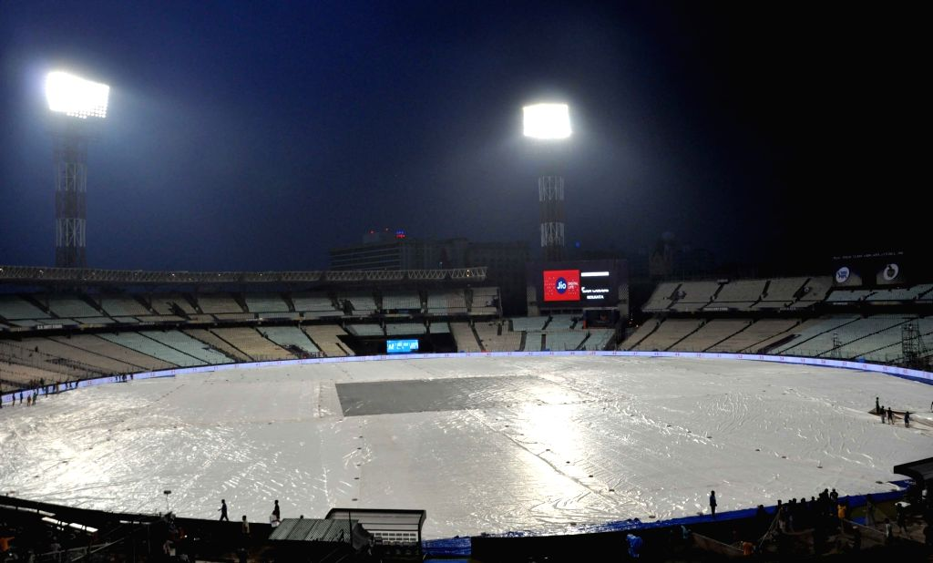 A view of the Eden Gardens ground covered up with plastic sheets during rains, in Kolkata on April 7, 2018.