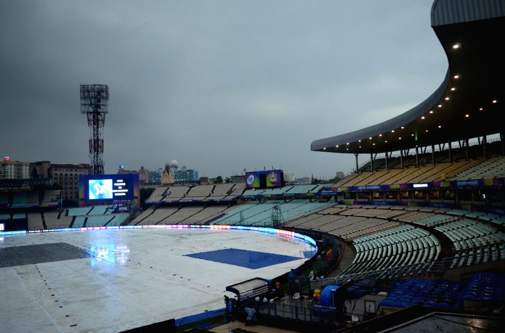 A view of the Eden Gardens ground covered up with plastic sheets during rains, in Kolkata on May 22, 2018.