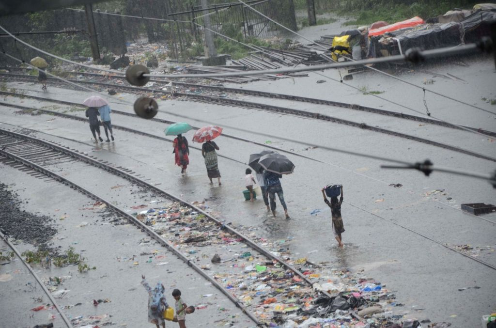 A view of the flooded railway tracks as heavy rains continues to batter Mumbai, its surroundings and large parts of Maharashtra for the third consecutive day, hitting normal life, disrupting ...